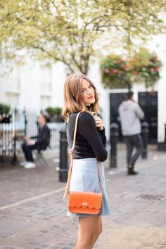 Black polo and blue suede skirt