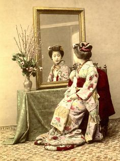 Gilt Mirror 1880s  Ѿ  A Senior Maiko (Apprentice Geisha) wearing the Yakko Shimada hairstyle.