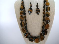 Black Brown Polished Tiger Eye Stone Double by SycamoreSticks, via Etsy.