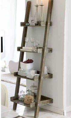 Cut the ladder down and insert trays for entry way as a shoe holder, keys etc, I like the old look of this latter shelf…good for bathroom, office, laundry…..