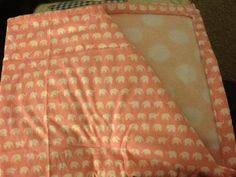 Medium sized cot/pram/Moses basket blanket. White elephants on pink backed with pink and white spot fleece <3