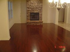 Love the dark hardwood floors and the stone fireplace!