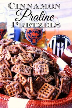 What do you get when you cross salty pretzels with sweet praline and cinnamon? Simply the most addicting, sweet and salty snack that's, perfect for munching while cheering on your favorite team. - Kudos Kitchen by Renee Candy Recipes, Holiday Recipes, Snack Recipes, Dessert Recipes, Kitchen Recipes, Christmas Recipes, Crock Pot Food, Pretzels Recipe, Salty Snacks