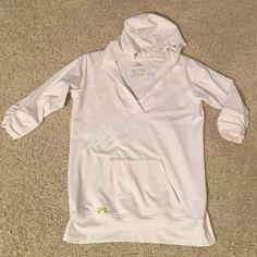 Under Armour allseason gear Ladies white hoodie with 3/4 sleeves. Lime green trim. Kangaroo pocket with iPod pocket. 90% polyester 10% elastane. Gently used. Under Armour Tops Sweatshirts & Hoodies