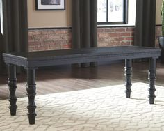 The Dannerville accent bench is all about vintage charm with present-day flair. Antiqued black finish brings character to this woody ensemble. Turned legs elevate the silhouette with curves. Accent Bench, Accent Chairs, Dark Grey Rooms, Ashley Furniture Industries, Furniture Depot, Target, Open Bookcase, Tufted Ottoman, Modern Farmhouse Style