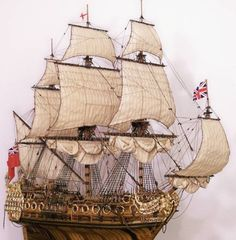 "The model is 100% scratch built, made out an 150 year old barn plank of Chestnut Wood, custom made, a One-Of-a-Kind Warship Model. The scale of this ship model is 1/96. The model is 27"" long x 12"" wide, and 25"" high mid-ship. And has 5 different deck levels, plank-on-frame construction. Total work hours on the model, 1,175, and about 10,000 pieces."