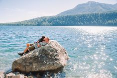man and woman laying on boulder at phelps lake in Jackson Hole Grand Teton National Park, National Parks, Teton Mountains, Whitewater Rafting, Family Outing, Posing Ideas, Beautiful Stories, Jackson Hole, Engagement Photos