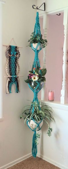 Here is a unique home for your houseplants!! This triple turquoise macrame plant hanger will steal all the attention.