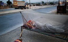 Islamabad: An elderly Pakistani man who fled his home sleeps on a roadside bed