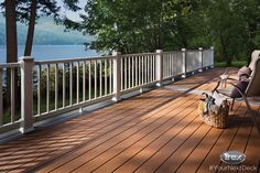 The best seat in the house is right outside the back door on this composite deck that features Trex Select decking in Saddle and Winchester Grey, and Trex Select Railing. Find more inspirational outdoor living spaces at www.Trex.com. #YourNextDeck