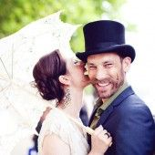 groom with a top hat, bride with a parasol, except phill will not have a dirty big moustache like that!!
