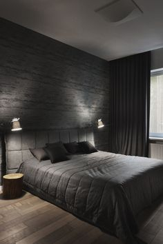 This is Sexy and Over-the-top Masculine Master Bedroom. Incredible textured wallpaper, love how the designer put drapes high from wall to wall making this room blackout (maybe he works nights). Wood floor headboard w matching bedding makes this room a Dream. If anyone knows it's interior designer let us know! Remember girls..no camera's!  2016