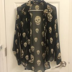 Sheer skull blouse Long sleeve sheer blouse with skull print. 2 buttons on cuff. Love Culture Tops Blouses