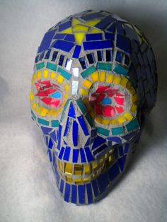 recycled stained glass on found styrofoam form.