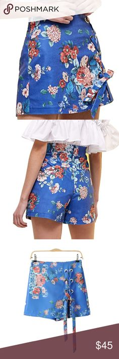 """Singing in the Rain Skort (skirt/short) zipper fly, wrap tie front design, look of a skirt but the comfort of shorts, vibrant print, mid rise style, polyester blend  📦✈️in stock items purchased today ship tomorrow (except Sunday's & Holidays)  🛒(optional) RESERVE NOW any out of stock sizes by purchasing """"arriving🔜"""" options & it will automatically ship when it is restocked Shorts Skorts"""