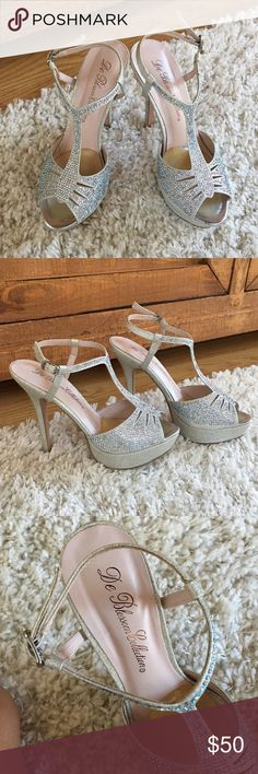 """De Bloosom Collection heels Good used condition. My daughter only used it once for senior prom. No wear just the bottom which is expected because it's on the ground. All rhinestones intact. 5"""" heel with a 1"""" platform. de bloosom collection  Shoes Heels"""