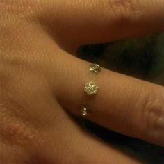Triple finger dermal piercing