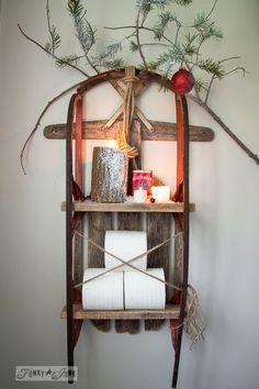 Snow sleigh toilet paper shelf with Christmas log candles on FunkyJunkInteriors.net #12days72ideas