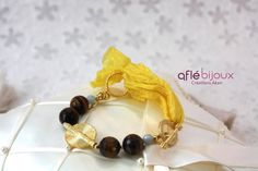 Cute bracelet made of bright yellow silk, tiger eyes, amazonite, Akan gold weight.  #aflebijoux #bijoux #jewelry #etsy