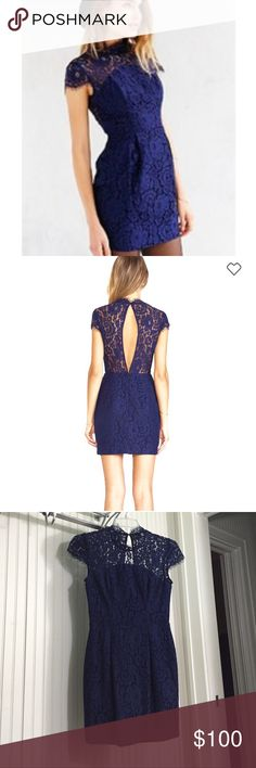 Keepsake Run The World Lace Dress Beautiful Keepsake of Australia  Run This World navy lace dress purchased from Urban Outfitters. Main fabric 50% cotton, 50% nylon. Contrast fabric 65% viscose, 35% cotton. Lining 100% poly. Hand wash cold. Hidden center back zip closure and back cut-out with button closure. Sold out online. Like new, only worn once. From smoke free home. Fits size 6-8, measurements available upon request. Keepsake Dresses