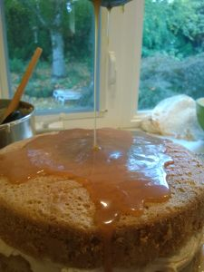 Salted Caramel Sauce over Cinnamon Apple Cake. Browned Butter Frosting to follow.    thesimplecake.com