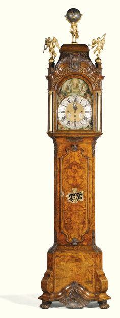 A walnut musical longcase clock, Paulus Bramer & Son, Amsterdam, circa 1750 10' 6'' H painted dial with silvered chapter ring signed Paulis Bramer, En Soon, Amsteldam, the matted centre with subsidiary day, date, month & moonphase indicators, tune selection indicator at III, the massive three train movement with Dutch striking on two bells, the pinned cylinder playing sixteen tunes on a carillon of nineteen bells with forty five hammers, the shaped trunk door with gilt-bronze mounted…