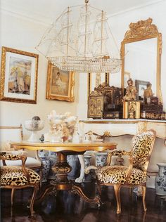 ship chandy, leopard print, blue and white...too much, really, but lots of good here. lusterinteriors.blogspot.com