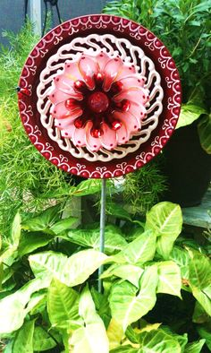 Garden Decor Glass Plate Flower [Saw some of these in person at my local farmers market - they are amazing and the way they sparkle in the sun is just beautiful - remember to use a carbon drill bit for DIY - CAM]