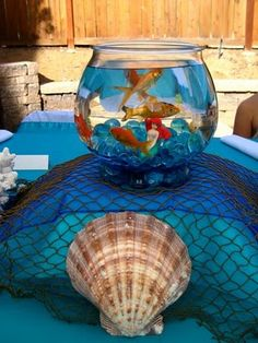 Create a splash with this Under The Sea Party Birthday Party Ocean Party! Including Fish bowl centerpieces, starfish cupcakes, tablescape, cake and Under the Sea Party Invitations! A great Under the Sea Birthday Party Ideas for kids and teens! Goldfish Centerpiece, Fishbowl Centerpiece, Bowl Centerpieces, Little Mermaid Birthday, Little Mermaid Parties, The Little Mermaid, Under The Sea Theme, Under The Sea Party, Little Mermaid Centerpieces