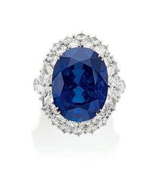 A fine 20.38 carats oval-cut Burma 'Royal Blue' sapphire and diamong ring, by Harry Winston