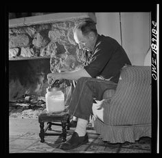 A stockman churning butter New Mexico 1943