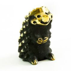 Smiling Hedgehog Figurine now featured on Fab.  Its so weird and cute at the same time!