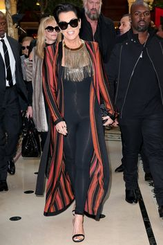 Arriving at the Balmain show in a striped red coat and statement necklace.
