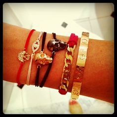 Arm Party- whistle, cartier and metal skull bracelets