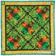 Village Green quilt pattern: Stitch your own little quilted neighborhood with this charming throw quilt designed by Karen Bialik.
