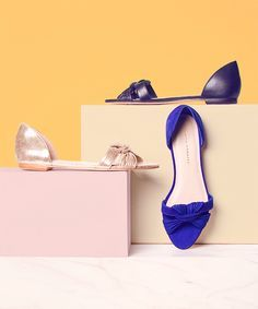 Product styling/ fashion photography. Interesting play on geometric and organic shapes, plus the complimentary background highlights the blue shoe.