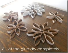 Toilet Paper Roll Snowflakes/Flowers. These would be pretty all over the house for Christmas or as a wedding backdrop