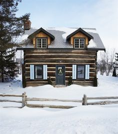 [11] Charming Log Cabin (© Angus Fergusson). This rural Collingwood cottage is ready for the holidays. This is the type of winter cottage dreams are made of. Quaint shutters painted robin's egg blue and classic wreaths make a pretty first impression. New cedar dormers enhance the exterior appeal, as well.