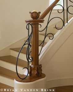 it's all in the details. Iron and wood railing. A soft Modern style beautiful curved iron design