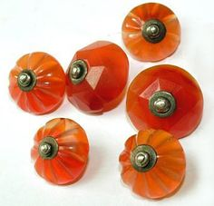 19th c. British made amber glass waistcoat buttons with center pin shanks.
