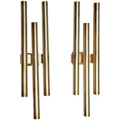 Pair of Gio Ponti Brass Sconces by Candle | From a unique collection of antique and modern wall lights and sconces at https://www.1stdibs.com/furniture/lighting/sconces-wall-lights/