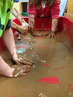 "Playing in ""Chocolate Mud""  Pre-kindergarten, preschool sensory table learning/play... Messy is memorable, right?! My pre-k kiddos loved it!  Ingredients: *3 cups corn starch *1/4 cup baking soda *1 cup cocoa powder *2 cups water"