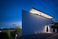 yoshiaki yamashita hides house in nara-zaka behind windowless façade - designboom | architecture