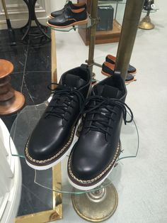 Modern twist on a skinhead type boot. White soles