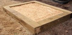 How to Build a Sandbox. Large timbers.