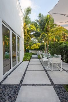 Indoor/outdoor living was the theme of the  modern, tropical garden landscape design in the heart of Key West. The architecture was done by Haven Burkee of Bender & Associates Architecture and the landscape was designed to reflect the contemporary architecture from the concrete pavers, to the minimalist grouping of the tropical plants.