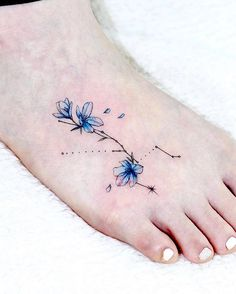Taurus astrology Delphinium tattoo on the foot by @aeri_tattoo - Gorgeous Taurus tattoo ideas - OurMindfulLife.com Small Side Tattoos, Small Girly Tattoos, Small Couple Tattoos, Horoscope Tattoos, Taurus Tattoos, Bull Skull Tattoos, Animal Tattoos, Cover Up Tattoos, Hip Tattoos