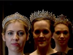 CARTIER TIARA TO BE AUCTIONED BY SOTHERBY'S - Employee's of Sotheby's auction house wear diamond tiaras from the estate of Mary, Duchess of Roxburghe, that were made by Cartier in the 1930s during a press event in London on Wednesday. The tiara worn at left a will be sold at auction in Geneva, Switzerland on May 12, with an estimated value of $306,000-505,000.