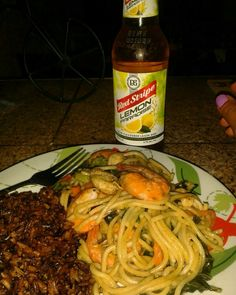 Fried rice with spaghetti and shrimp with a cold Red Stripe Lemon flavor Beer