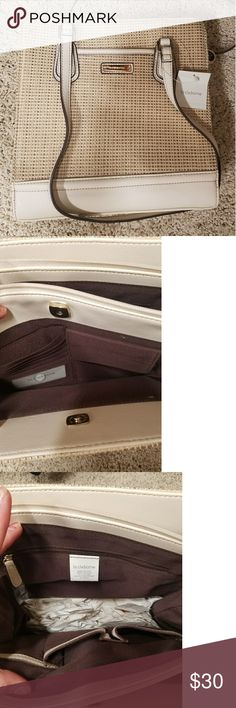 Liz Claiborne tan purse, lots of storage! Has three separate sections shown in pictures. Has never been used. It has a ton of pockets and great handle length. No flaws! PRICE NEGOTIABLE! Liz Claiborne Bags Shoulder Bags